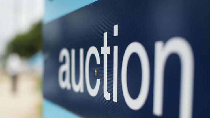 Auction survival guide: Bid on your dream home without letting emotion get the better of you